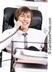 Successful businessman talking by phone