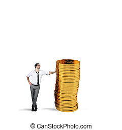 Successful businessman with a pile of money