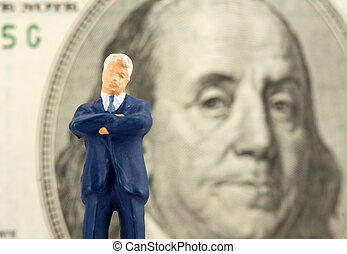 Successful businessman with Franklin on background