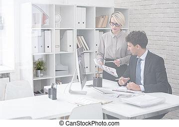 Successful Businessman with Secretary