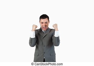 Successful businessman with the fists up against a white...