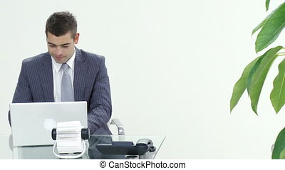 Footage in high definition of happy businessman working in office celebrating a success
