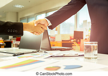 Successful businessmen handshak agreement after good deal in office.