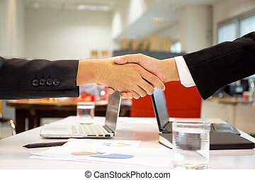 Successful businessmen handshak agreement after good deal in office.
