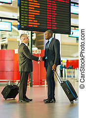 businessmen meeting at airport