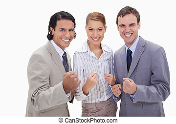 Successful businessteam standing against a white background