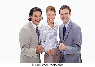 Successful businessteam standing together against a white...