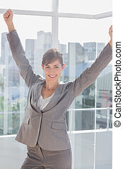Successful businesswoman cheering and smiling
