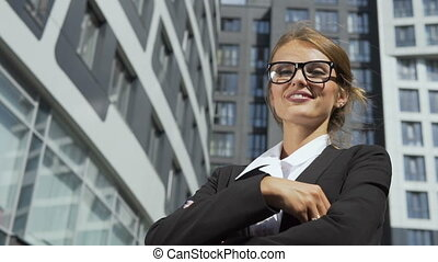 Successful Businesswoman in front of Corporation