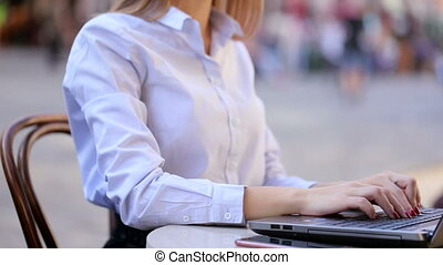 Successful businesswoman is talking with her client in her laptop. She just succeed and is feeling very happy now