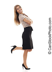 Successful businesswoman kicking up foot