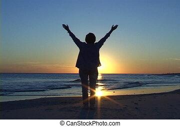 Successful businesswoman raises her hands in triumphant at ...