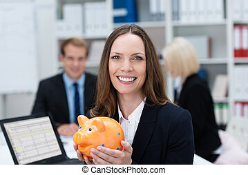 Successful businesswoman with a piggy bank