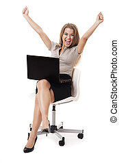 Successful businesswoman with laptop on knees