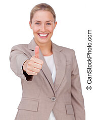 Successful businesswoman with thumb up