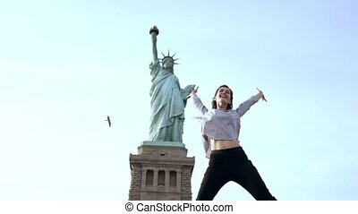 Successful Caucasian female student jumping high with joy...