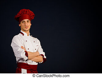 Successful Chef - photo of young successful chef in front of...