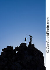 Successful climbing team. - Team of male climbers conquer...