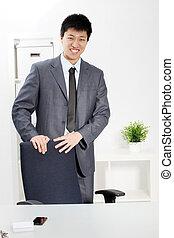 Successful confident Asian businessman