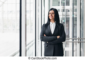 Successful confident business woman in an office setting