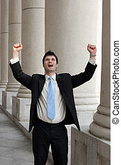 Successful corporate man. - Young businessman throws his...