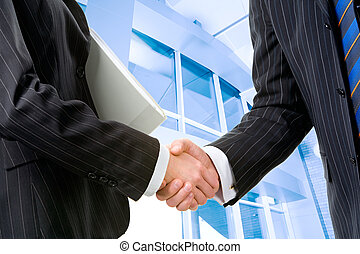 Successful deal - Two partners shaking hands at meeting in ...