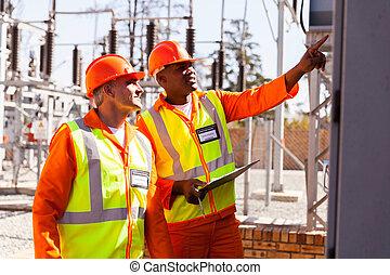 electrical engineers taking machine readings