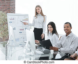successful employee is standing by flipchart in office