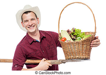 Successful farmer with a crop of vegetables in the studio on a white background