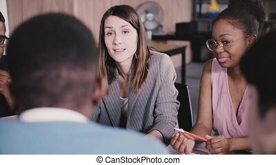 Successful female business coach inspiring multiethnic...