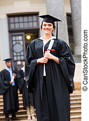 successful female graduate at graduation