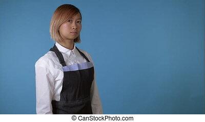 successful female wearing apron - attractive korean cook...