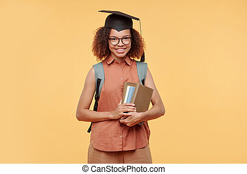 Successful graduate student with books