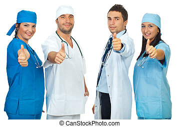 Successful group of doctors giving thumbs