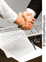 Successful handshake - Image of human hands holding each ...