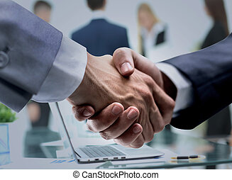 Teamwork and team spirit handshake in a group after work stock successful handshake of business men in a working environment sciox Choice Image