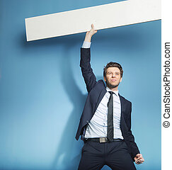 Successful handsome guy with the empty board