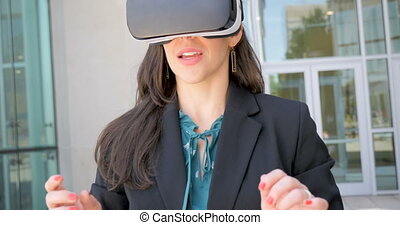 Successful happy woman celebrating in virtual reality with VR headset