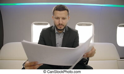 Successful lawyer businessman looking at documents sitting...