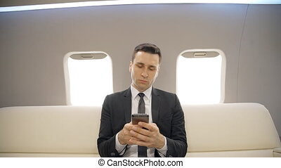 Successful lawyer businessman typing messages on chief...