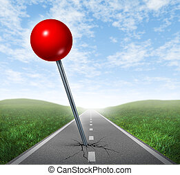 Successful location direction business symbol with a red push pin pinned and marked on a perspective oriented aspalt road as an icon of vision and acheiving your goals.