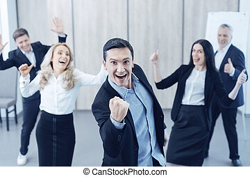 Successful male person making strong fist - We did it....