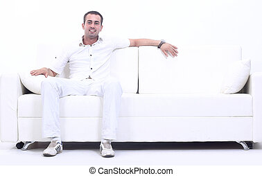 successful man sitting on the couch
