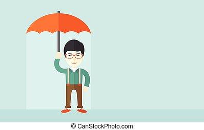 Successful man with umbrella.