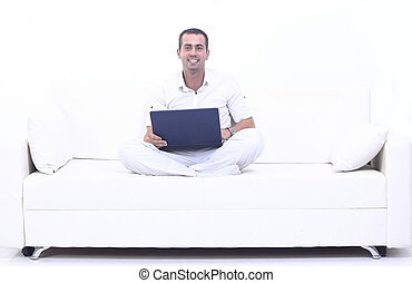 man working on laptop, sitting on the couch - successful man...