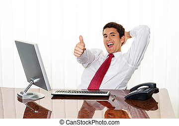 successful managers sitting at desk