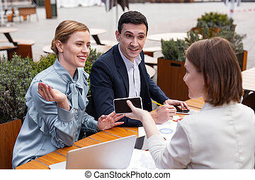 Successful married business couple attending staff meeting