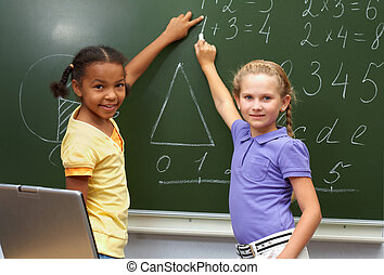 Successful mathematicians - Portrait of smart schoolgirls by...