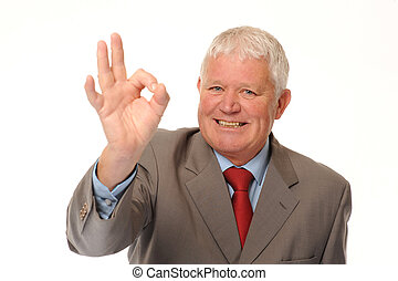 Successful mature business man on white background, giving okay sign
