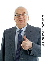 Successful mature businessman with thumbs up